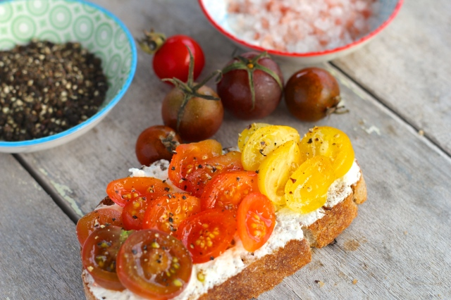 Goat cheese & tomato on toast, with salt & pepper