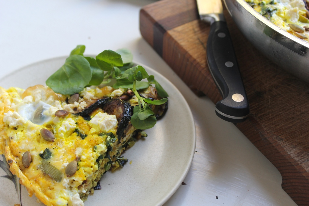 leek-zucchini-frittata-slice-greens